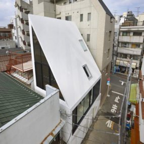 Angled roof house stands out in the city
