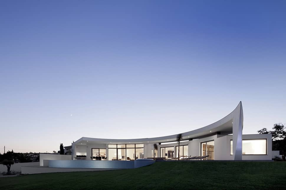 Arc House With Luxury Interiors And Edgy Curved Roof