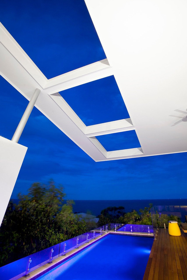 beach-house-with-bold-exterior-minimalist-interiors-11.jpeg