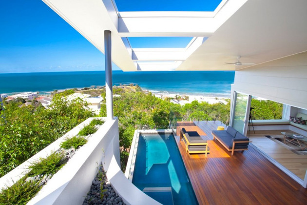 beach-house-with-bold-exterior-minimalist-interiors-12.jpeg
