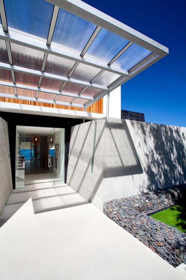 beach-house-with-bold-exterior-minimalist-interiors-6.jpeg