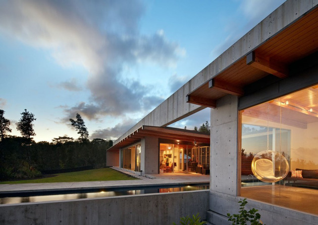 cool concrete house with glass walls captures outdoor living 1 thumb 630x447 11247 Wide open home plan on Big Island of Hawaii