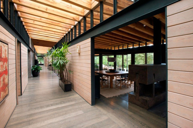 forest-house-brings-indoors-out-through-glass-walls-terraces-10.jpg