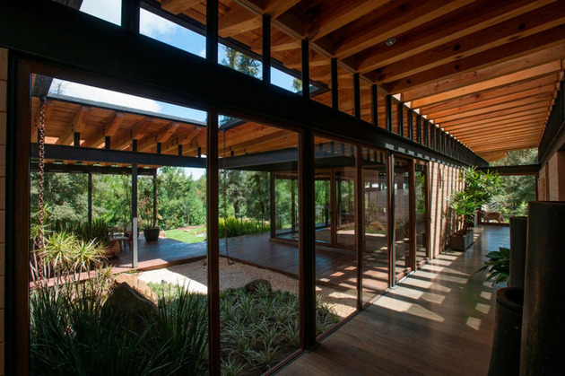 forest-house-brings-indoors-out-through-glass-walls-terraces-15.jpg