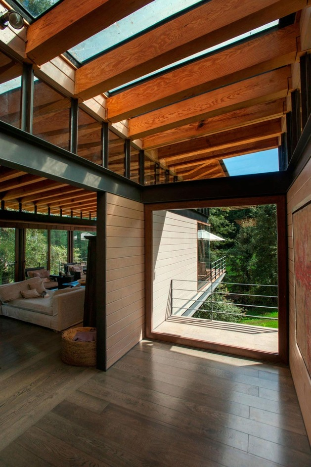 forest-house-brings-indoors-out-through-glass-walls-terraces-16.jpg