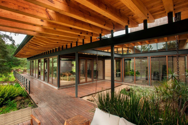 forest-house-brings-indoors-out-through-glass-walls-terraces-21.jpg