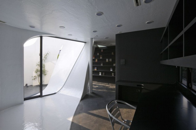 futuristic-curved-wall-house-integrates-nature-and-architecture-12.jpg