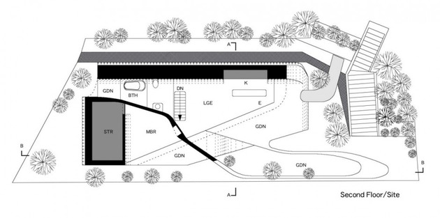 futuristic-curved-wall-house-integrates-nature-and-architecture-25.jpg