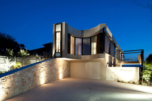 modern-beach-house-with-curved-window-wall-32.jpg