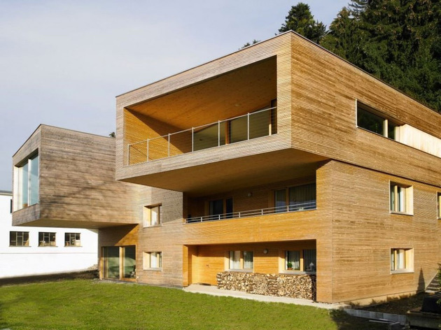 sculptural-wood-house-with-stacked-additions-for-three-families-4.jpg