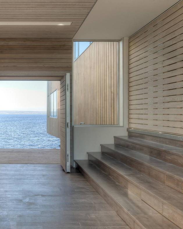 boat-inspired-wood-house-hanging-over-the-ocean-11.jpg