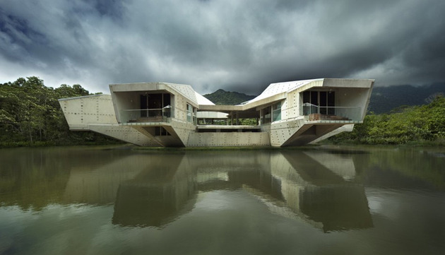 futuristic-concrete-house-with-bridge-access-and-eco-appeal-4.jpg