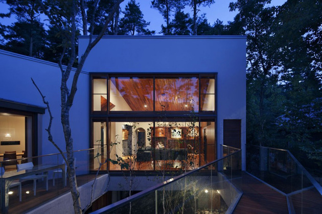 skewed-linear-house-plan-integrates-trees-and-architecture-16.jpg
