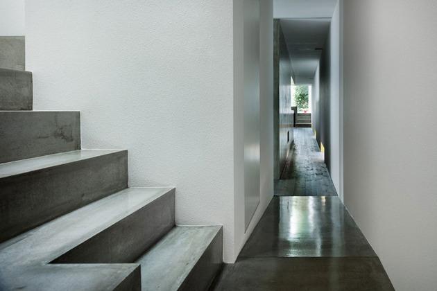 narrow-urban-home-with-concrete-walls-and-upper-bridge-5.jpg
