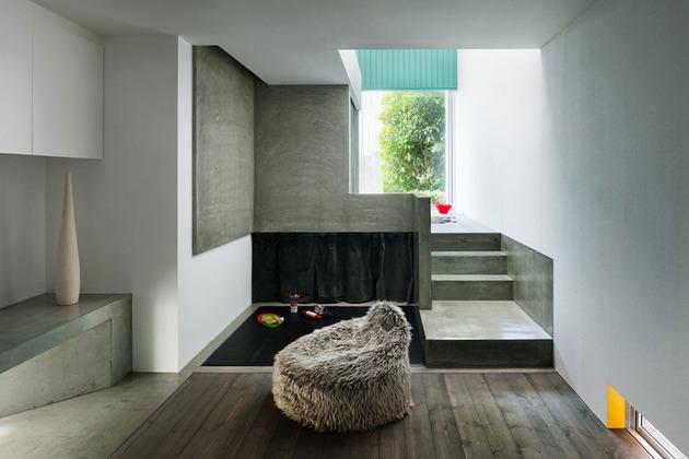 narrow-urban-home-with-concrete-walls-and-upper-bridge-7.jpg