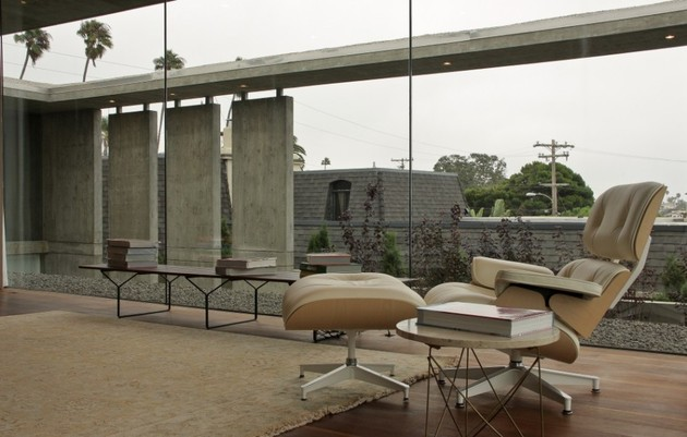 concrete-residential-architecture-designed-spacious-8-eames-lounger.jpg