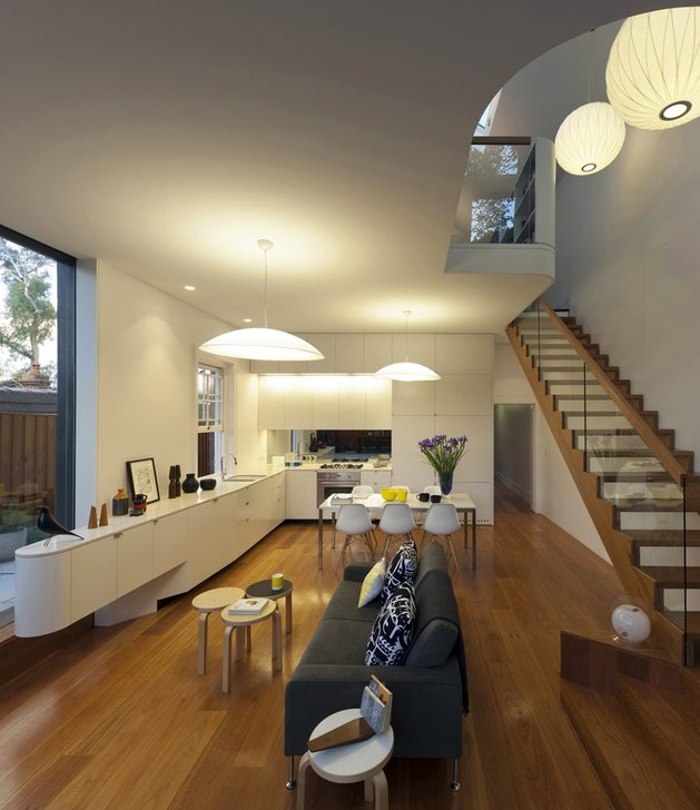familiar-touches-modern-design-sydney-home-13-living-room-stairs-night.jpg