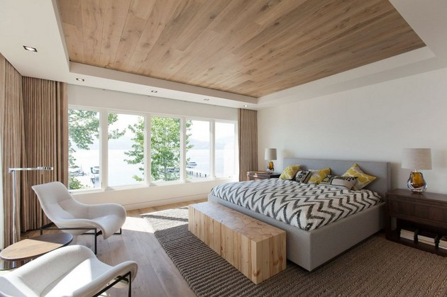 lakeside-vacation-home-combines-natural-materials-modern-living-20-master-bedroom.jpg
