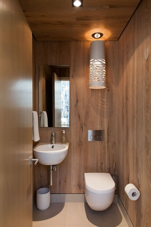 lakeside-vacation-home-combines-natural-materials-modern-living-26-powder-room.jpg