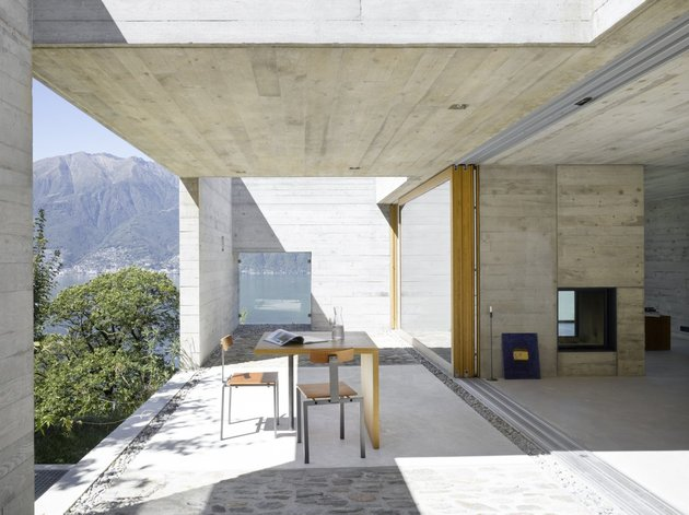 minamalist-concretehome-showcases-stunning-views-and-contemporaryliving-5-sliding-doors.jpg