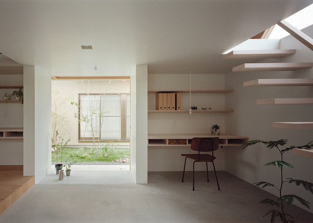 minimal-extension-adds-chic-usable-space-japanese-home-9-stairs-entrance.jpg