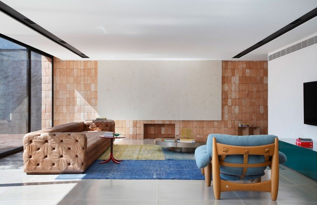 minimally-built-home-striking-public-private-spaces-11-seating-colors.jpg