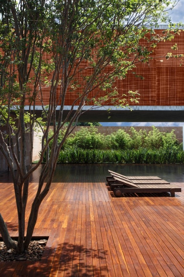 minimally-built-home-striking-public-private-spaces-7-wood-deck.jpg