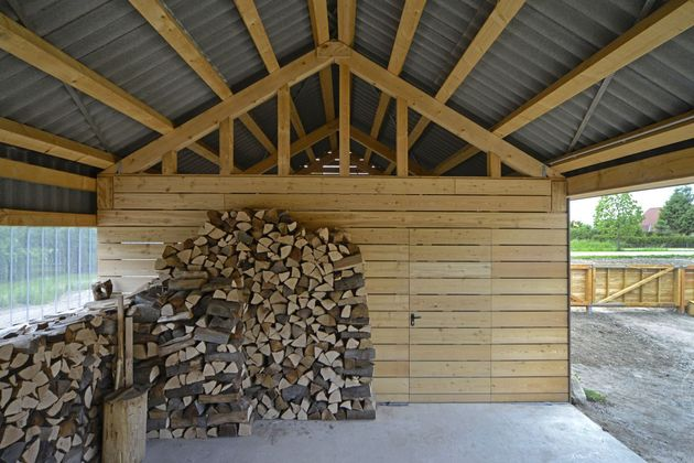 modern-open-concept-homestead-centralcourtyard-germany-13-woodshed.jpg