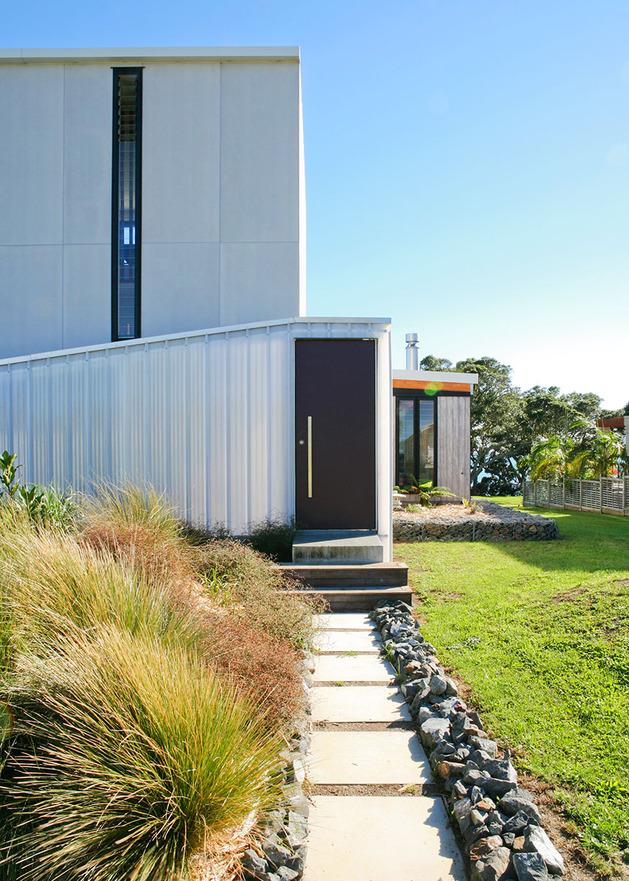 modern-suburban-lake-house-designed-private-beachside-living-4-entry.jpg
