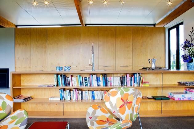 modern-suburban-lake-house-designed-private-beachside-living-7-chairs.jpg