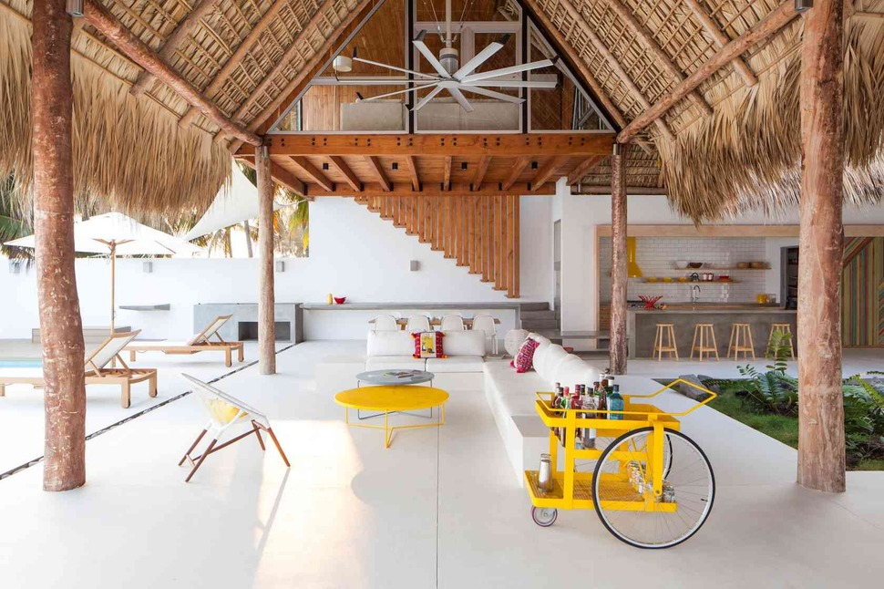 View In Gallery Colorful Tropical Open Home Rough Cut Thatched Roof