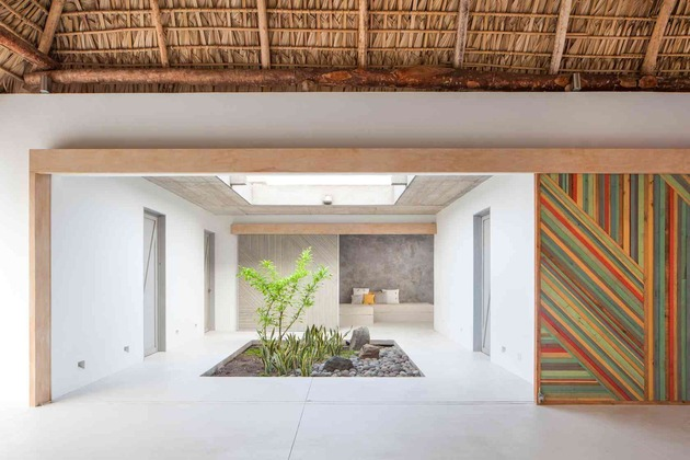 colorful-tropical-open-home-rough-cut-thatched-roof-9-private-space-entrance.jpg