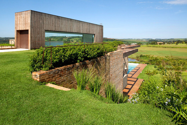 contemporary hillside home brazil disappears into landscape 1 thumb 630x420 21009 Contemporary Hillside Home in Brazil Disappears into the Landscape