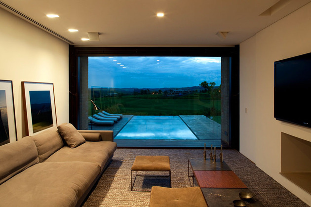 contemporary-hillside-home-brazil-disappears-into-landscape-10-media-room.jpg