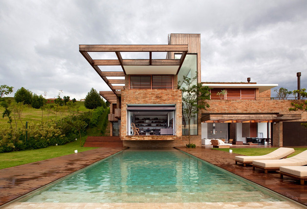 contemporary-hillside-home-brazil-disappears-into-landscape-4-pool.jpg