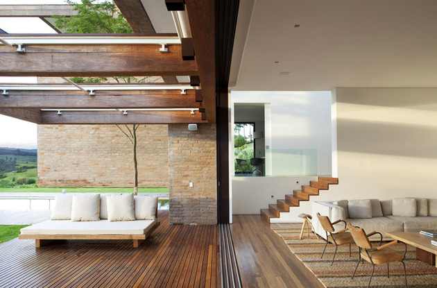 contemporary-hillside-home-brazil-disappears-into-landscape-6-lounging.jpg