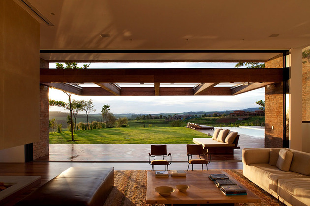contemporary-hillside-home-brazil-disappears-into-landscape-7-living.jpg