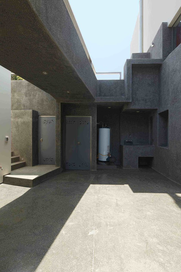 creatively-cool-dual-cantilevered-house-peru-12-downstairs-outdoor-storage.jpg