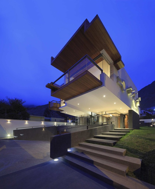 creatively-cool-dual-cantilevered-house-peru-4-front-below-patterned-side-night.jpg