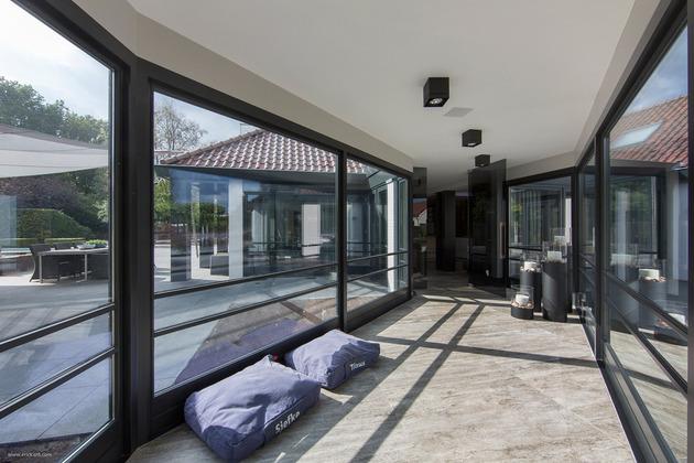 custom-details-create-visual-feast-minimalist-home-13-glass-walkway.jpg