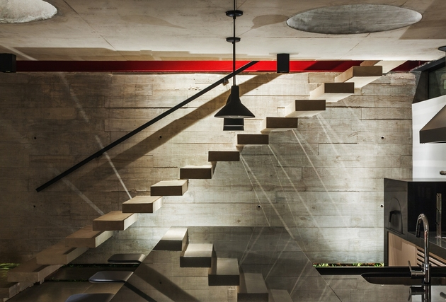 dual-direction-concrete-home-surrounds-poolside-courtyard-brazil-11-stairwell-bar.jpg