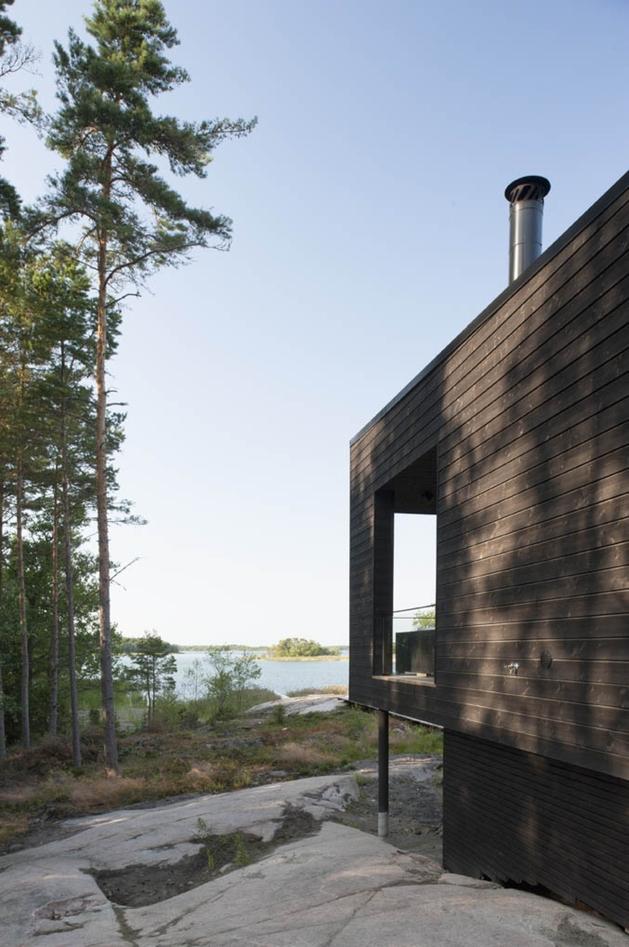 entry-summer-villa-vi-slices-through-home-to-lakeside-dock-5-deck.jpg