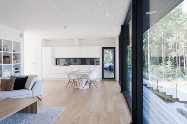 entry-summer-villa-vi-slices-through-home-to-lakeside-dock-7-living.jpg