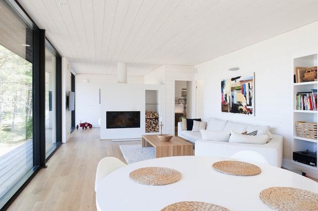 entry-summer-villa-vi-slices-through-home-to-lakeside-dock-8- living.jpg