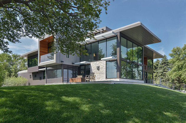 glass lake house features modern silhouette of earthy materials 1 thumb 630x418 19008 Glass Lake House Features Modern Silhouette of Earthy Materials