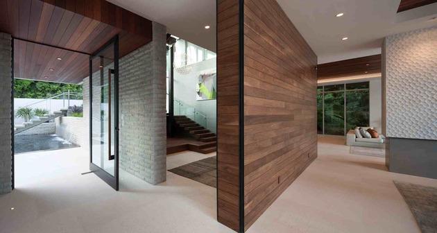 massive-ultramodern-hillside-los-angeles-jet-set-estate-10-divider-stairs.jpg