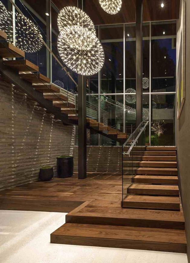 massive-ultramodern-hillside-los-angeles-jet-set-estate-11-lit-staircase-bottom.jpg