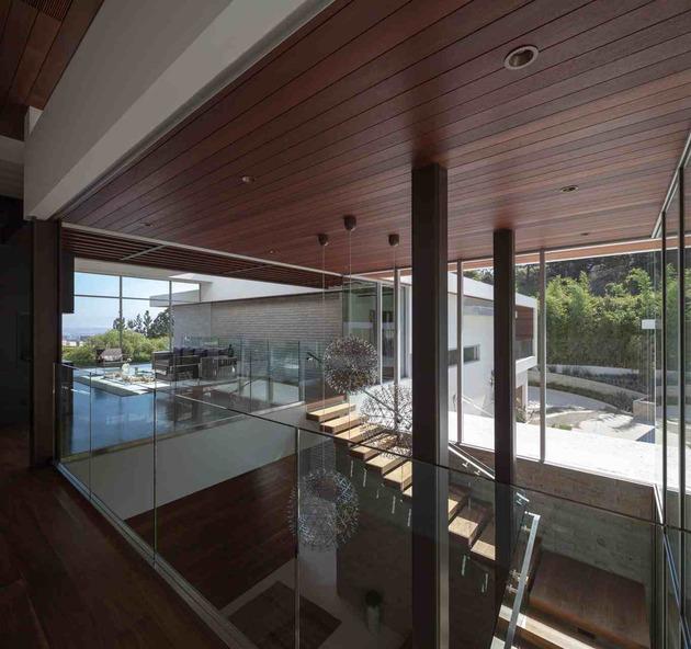 massive-ultramodern-hillside-los-angeles-jet-set-estate-12-daytime-staircase-top-far.jpg