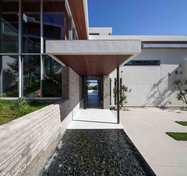 massive-ultramodern-hillside-los-angeles-jet-set-estate-4-doorway.jpg
