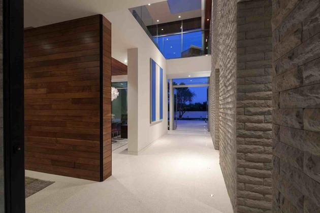 massive-ultramodern-hillside-los-angeles-jet-set-estate-6-entry-hall-front-angle.jpg
